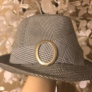 A gray, black, and white hat.